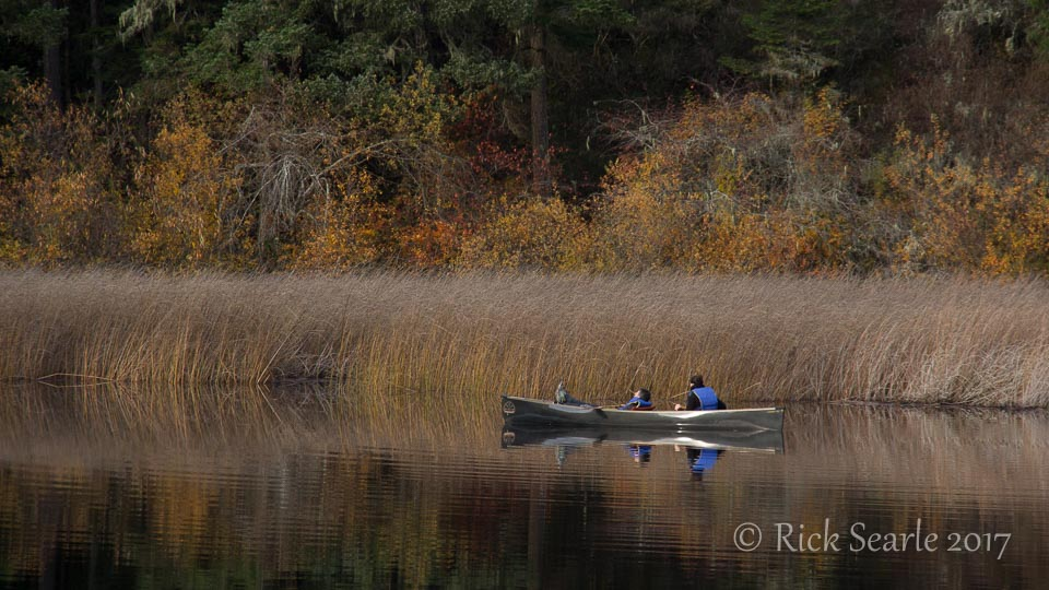 Canoeists on lake