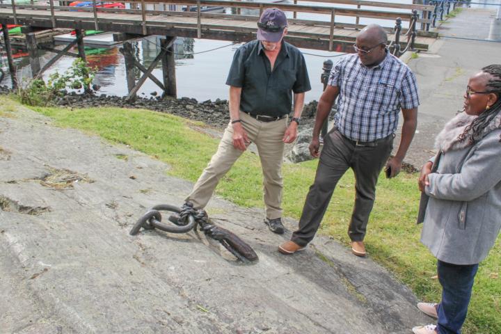 Rick and Guests Examining Historic Mooring Ring
